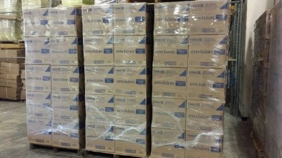 boxes stacked on pallets and shrinkwrapped