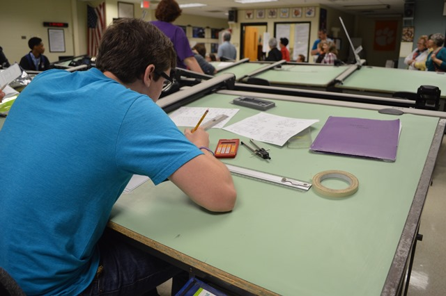 Student working on a drafting table