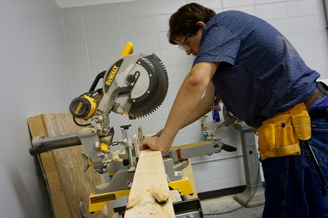 Student working with tablesaw