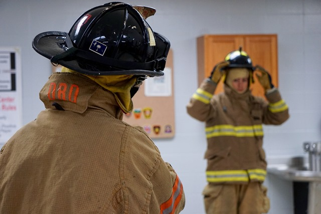 Two students in fire-fighting attire
