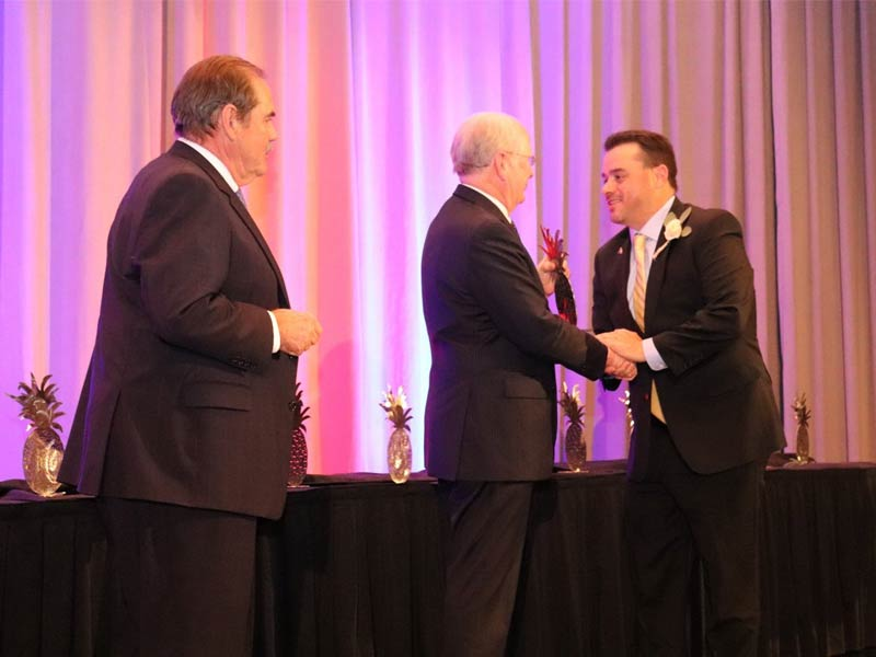 GCS FANS Director Joe Urban accepts the award from John Durst, President and CEO of the SCRLA and Bobby Williams, Chairman of the Board for the SCRLA and owner of the Lizard's Thicket restaurants.