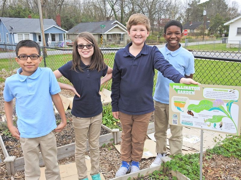 Four Cherrydale students in Pollinator Garden