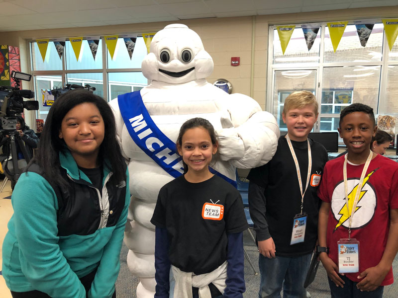 Students at East North Street Academy pose with the Michelin Man before the announcement