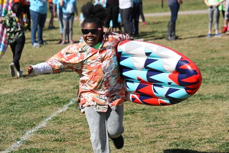 students run the surfing relay